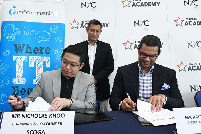 Nicholas Khoo, Chairman, SCOGA signing a partnership for the launch of The Esports Academy with Raiford Cockfield III, Director of APAC Partnerships, Twitch.