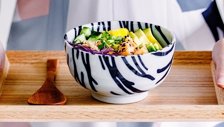 salmon-poke-bowl-1-s-_person-holding-bowl