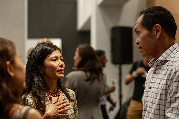 Kenny Eng (right) chatting with Audra Morrice at a STORM event.